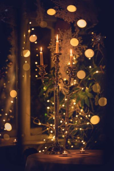 Vintage candlestick used as a Christmas decoration