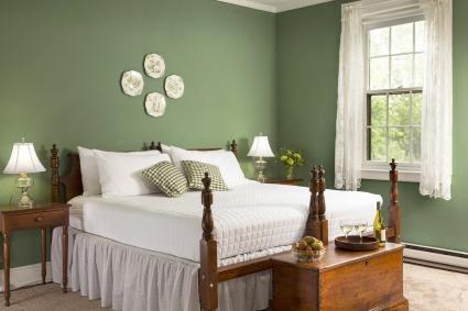 Two beds together in green bedroom