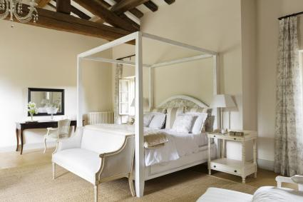 French country house in Provence with a vintage bench in the bedroom