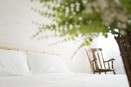Interior decoration, farmhouse style, palette bed, rocking chair