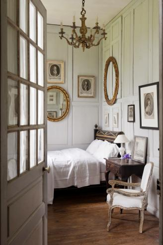 Charming bedroom with wooden wall panelling and french antiques