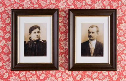 Two photographs hanging on a wall