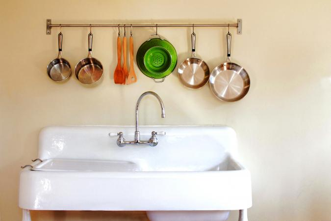 Antique kitchen farm sink with hanging pots