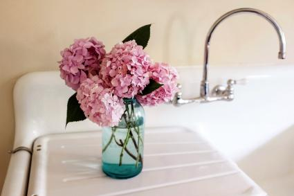 Pink hydrangea arrangement on a kitchen sink