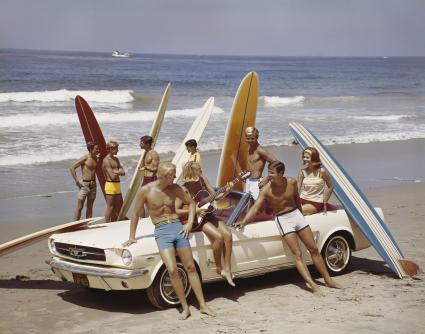 Retro art scene of friends with surfboards on the beach beach