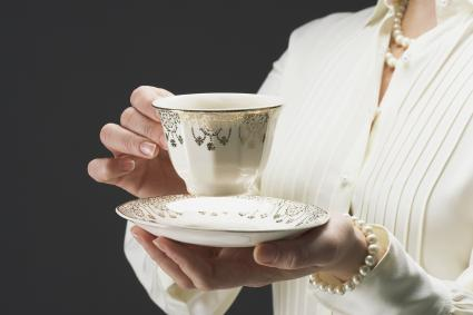 Woman with fine china cup and saucer
