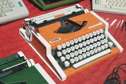 Orange Olympia typewriter for sale
