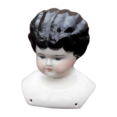 Vintage porcelain doll head