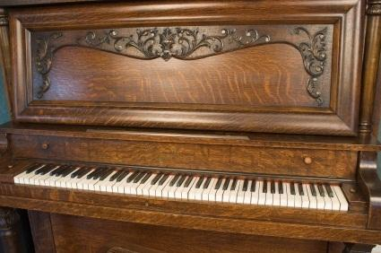 antique upright piano