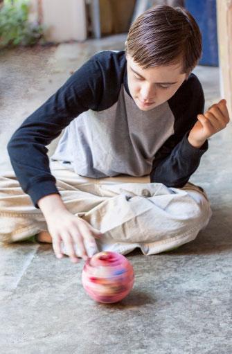 Boy spinning ball