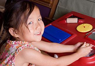 Girl using sensory station