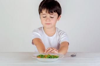 boy eating vegetables