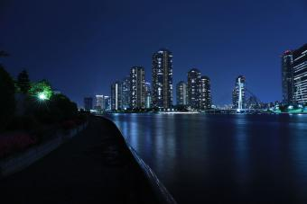 Illuminated City Against Blue Night Sky
