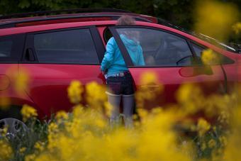 Girl getting into car