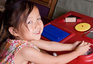 Girl using sensory station