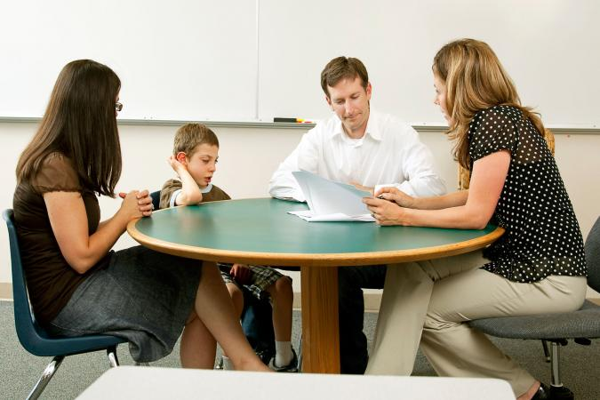 team of adults meeting about child