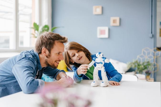 adult and child playing robots