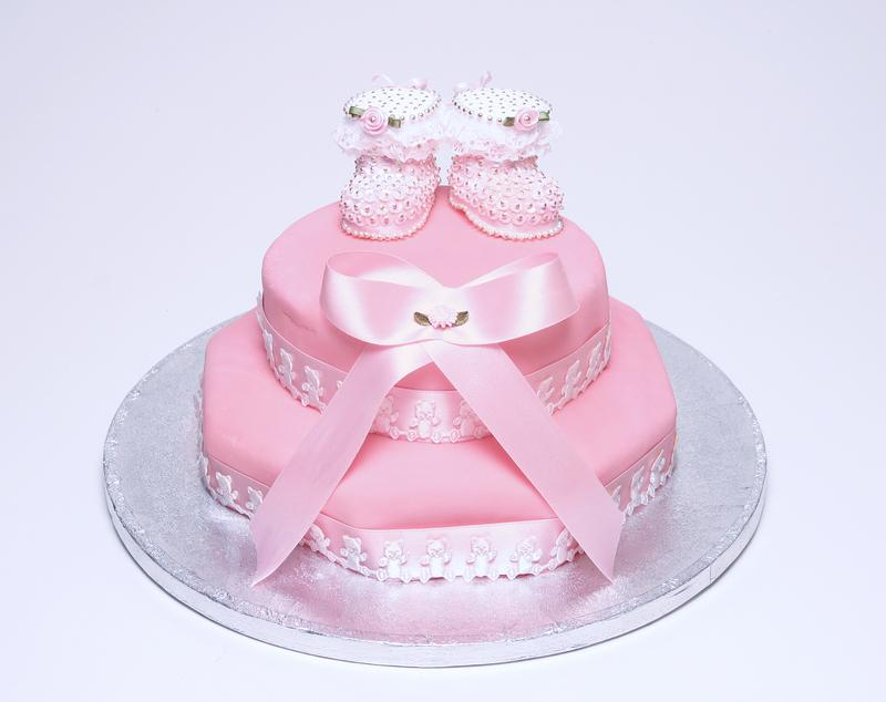 Pink Cake With Baby Booties Topper Copyright Gordon Ball At Dreamstime