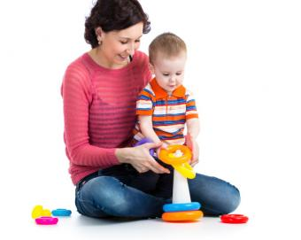 Mother and baby playing with a toy