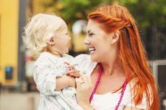 laughing mom with toddler