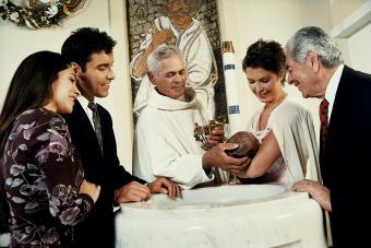 Holding Baby at Baptismal Font