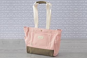 https://cf.ltkcdn.net/baby/images/slide/215441-704x469-Birdling-Mini-Day-Tripper-Pink-Diaper-Bag.jpg