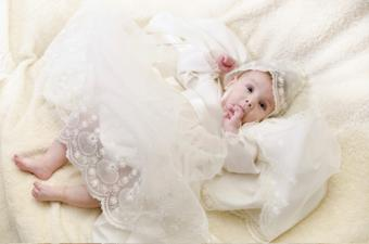 Image of a baby in baptismal clothing