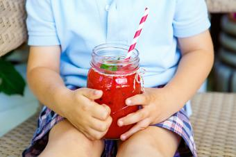 boy drinking healthy fruit smoothie