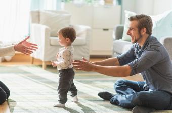 parents helping little son