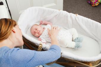 Mother comforting newborn