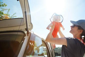 Mom taking baby out of car