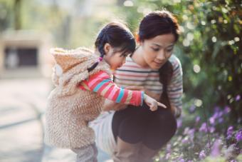 girl & mom admiring flowers