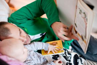 Father reading bedtime story to baby