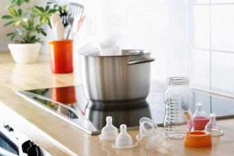 Sanitizing baby bottles on stove