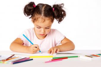 toddler working in a workbook