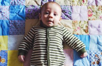 baby boy lies on a blanket