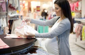 Pregnant woman shopping baby clothing