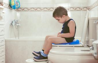 Boy sitting on a potty chairs