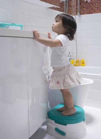 Child standing on potty