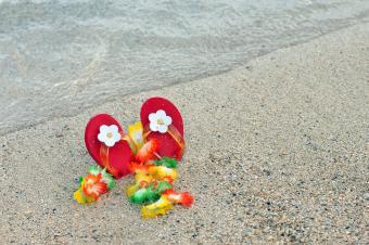 Baby girl flip flops in the sand