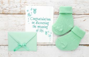 New baby card with small socks