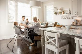Family with a baby and a small boy having breakfast
