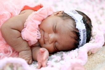 Newborn baby girl wearing headband