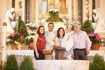 baby, parents, and godparents at baptism