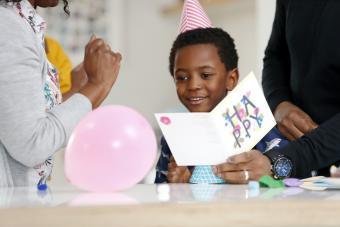 Boy receiving birthday card