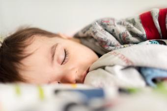 Toddler sleeping recovering from the cold and flu season