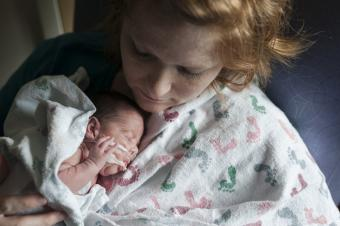 NICU baby is nurtured by mother