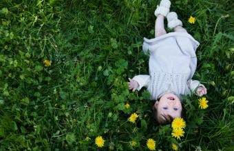 baby girl lying in the grass