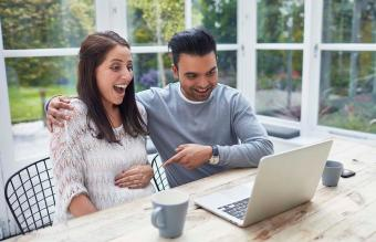 Expecting couple having video conference