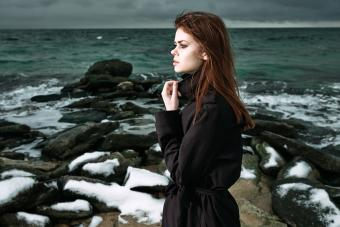 Girl at the sea dressed in black